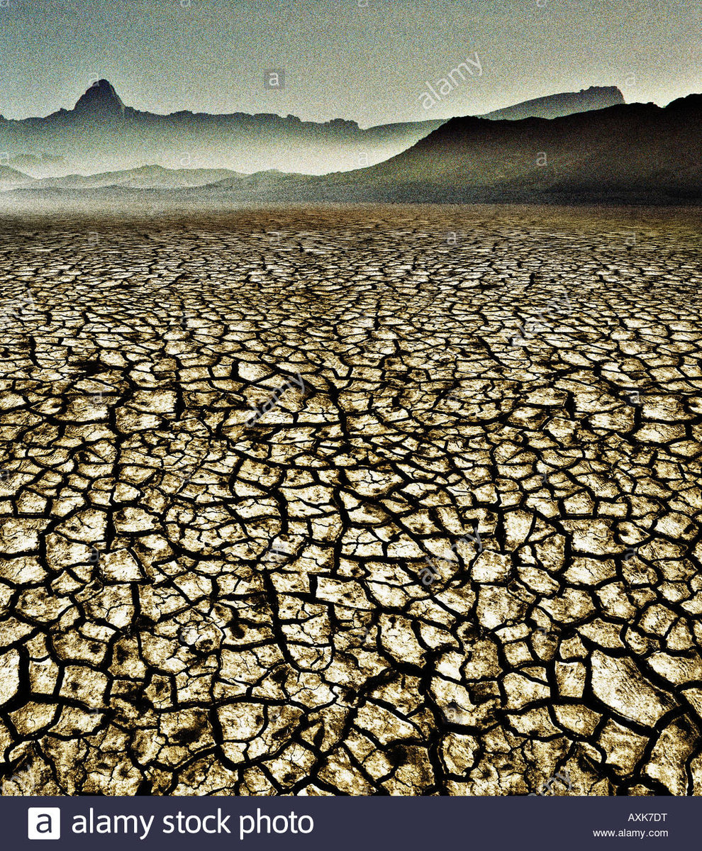 a-bleak-desert-with-drought-and-cracked-mud-from-global-warming-AXK7DT.jpg
