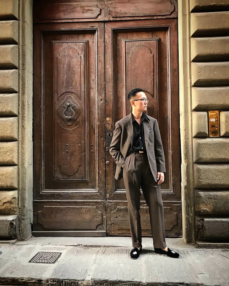 Brycelands-Kenji-Cheung-with-a-grey-suit-accented-by-a-black-shirt-and-black-slippers..jpg