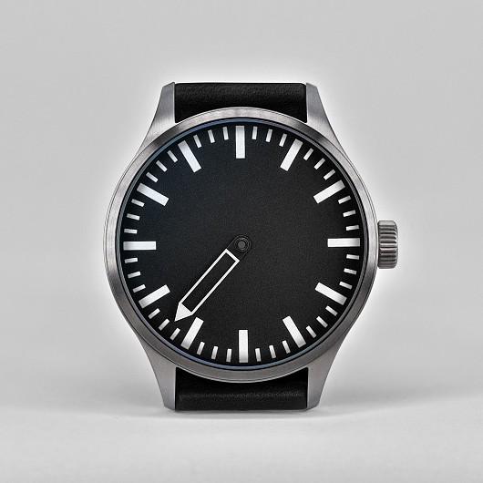 defakto_eins_11_sw_2000_frontal_single_hand_watch_design_final_2021.jpg