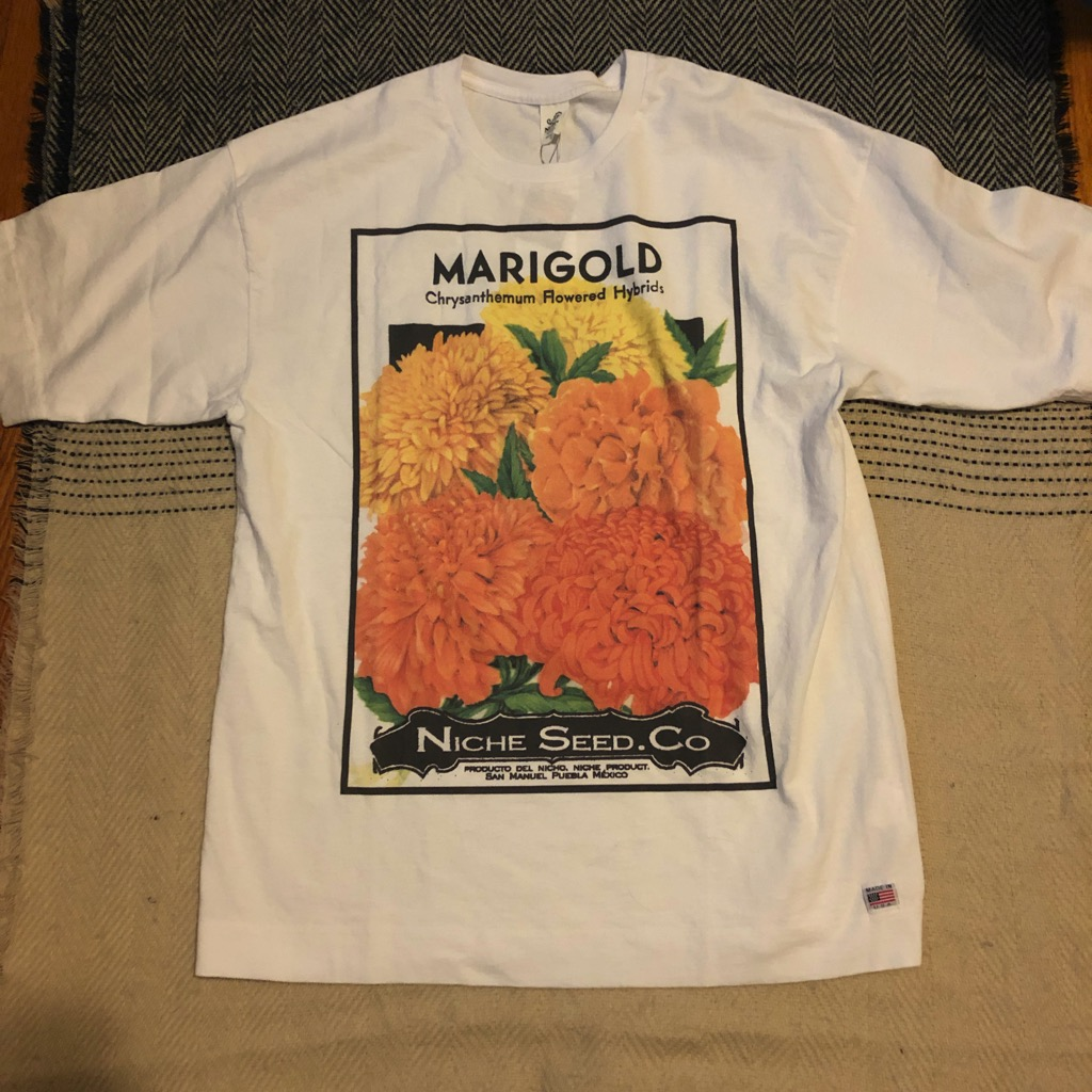 Niche marigold seed tee in white in size L.jpg