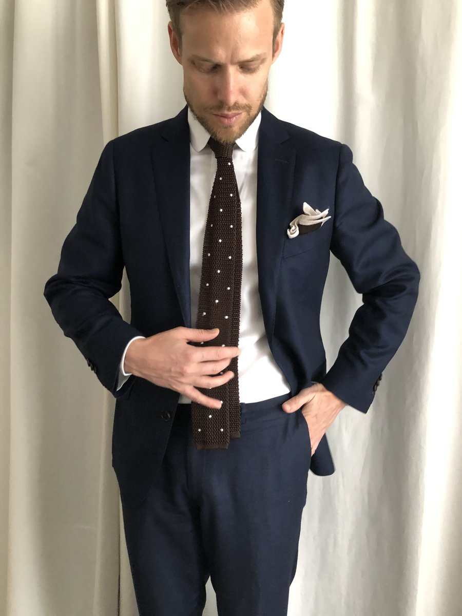 Once a day - suit and knitted tie.jpg