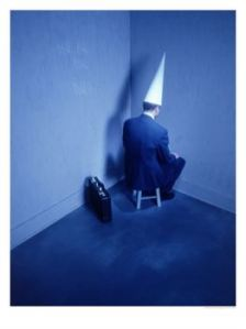 386410abusinessman-sitting-in-corner-with-dunce-hat-posters1.jpg?w=224&h=300