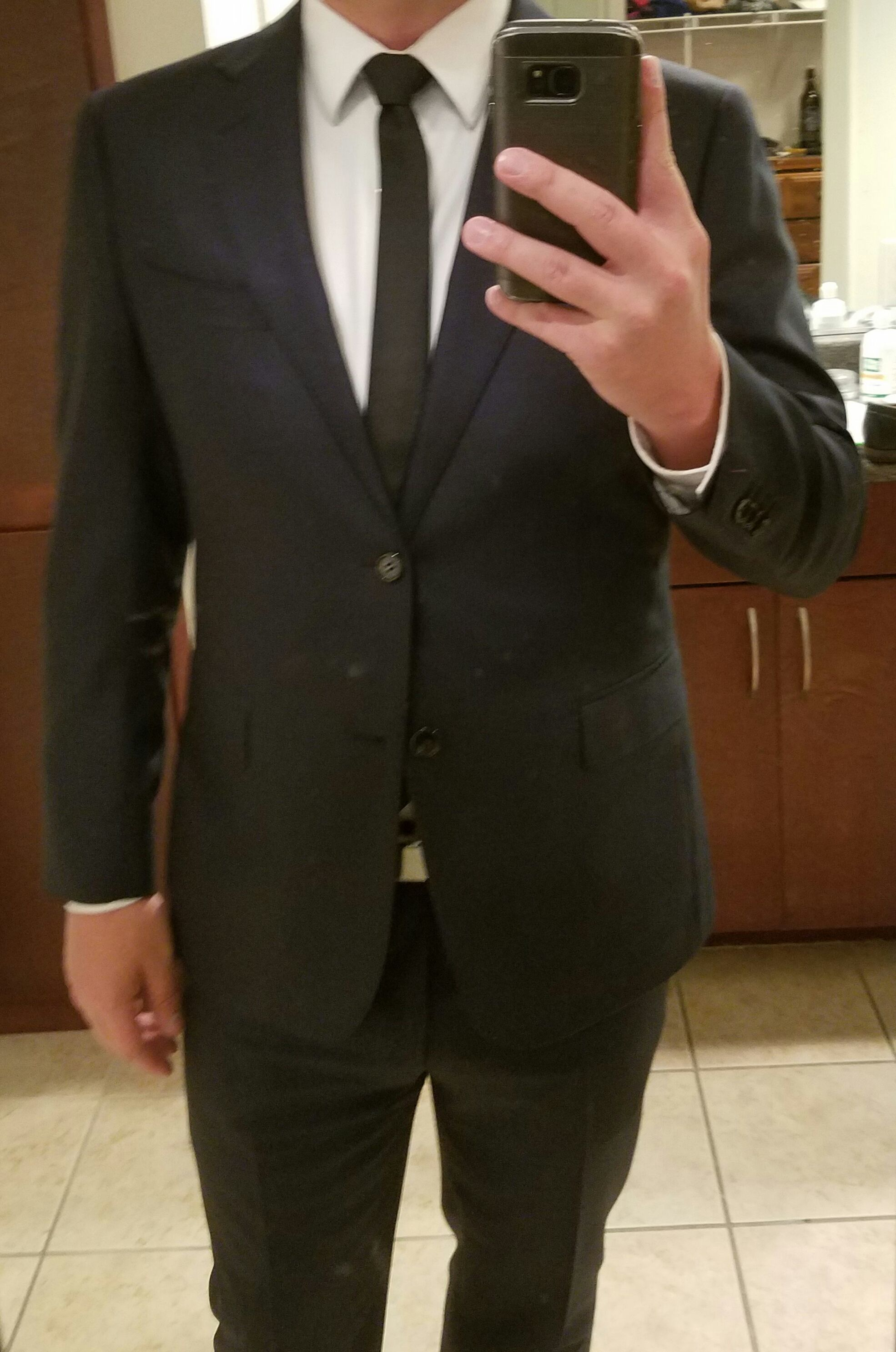 navy suit black tie