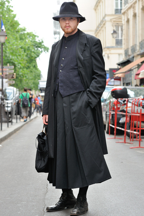 """Me shot by Monsieur Jerome, outside Yohji Yamamoto. Wool felt hat, wool gabardine """"Yohji jacket"""", wool gabardine waistcoat, white cotton button-up shirt (with collar and cuffs detached), leather belt, wool gabardine hakama, wool gabardine bag, all by Yohji Yamamoto Pour Homme. The boots are from the beginning of the 20th century."""