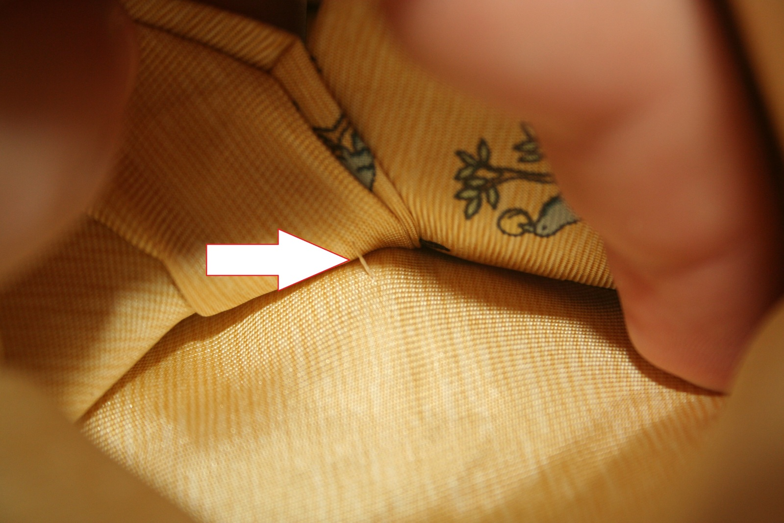 spot fake hermes tie