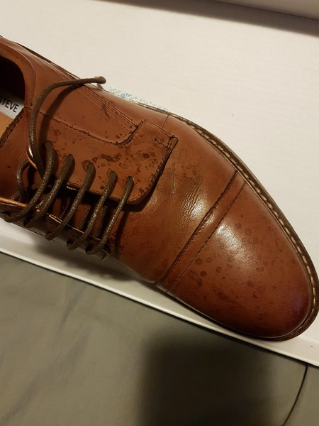 Water marks on new brown leather shoes