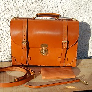 A hand stitched Light Havana 2 pocket briefcase, with polished brass fittings. extra corners and accessories