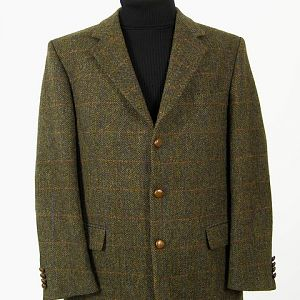Green check Harris Tweed jacket with elbow patches.