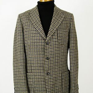 Vintage Harris Tweed jacket.  Grey, olive green and black houndstooth check, patch pockets.