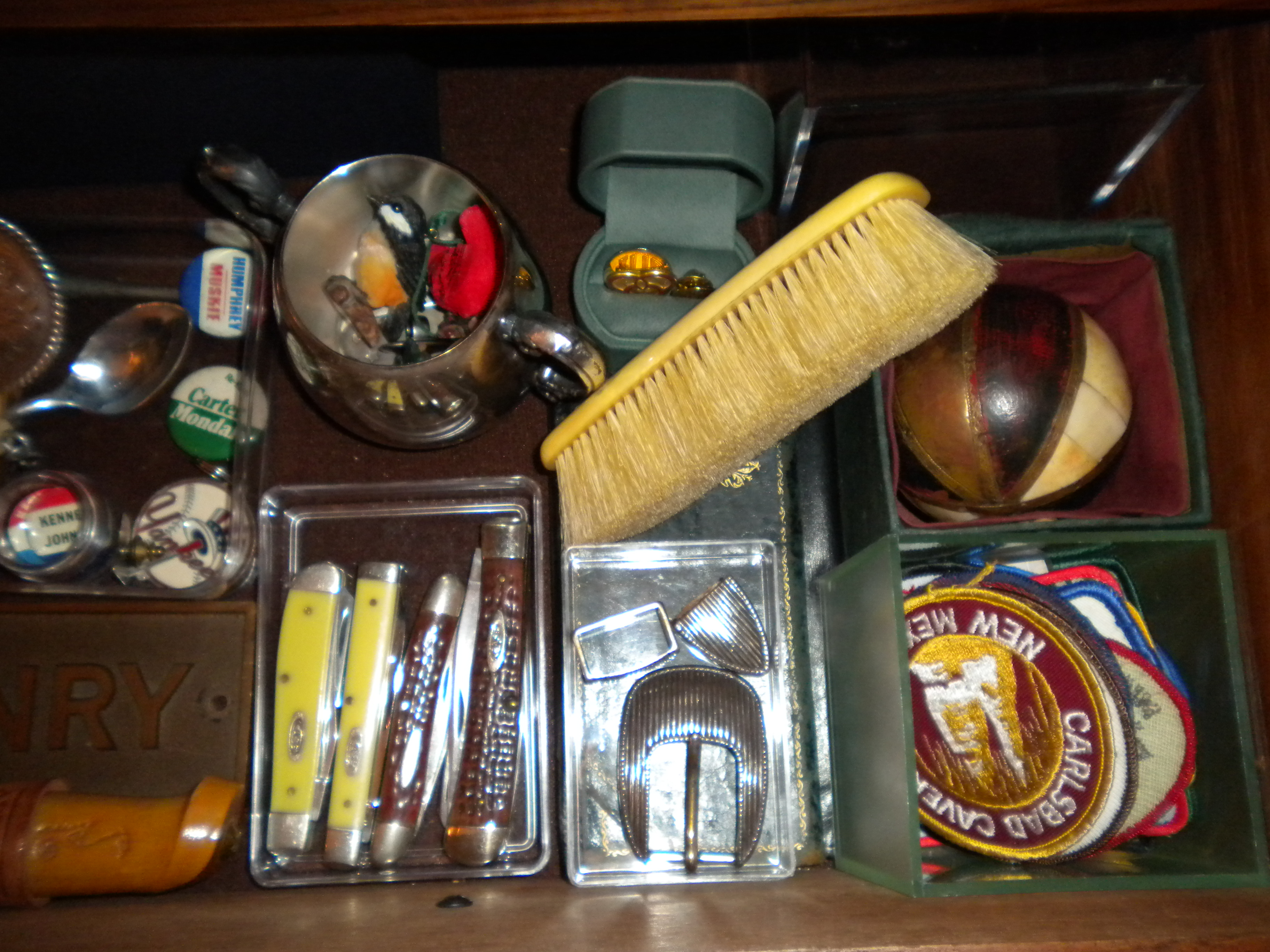 Nice clothes brush here, scout camping badges, campaign buttons, case knives, beltbuckle set